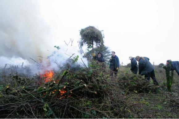 Looking NW at site clearance by burning of the cut vegetation; 10th January 2013