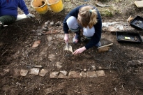 Looking W at trench 1A showing un-mortared bricks on E edge; 7th April 2013