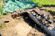 Looking SW at corrugated iron sheet and other finds; 14th June 2013.