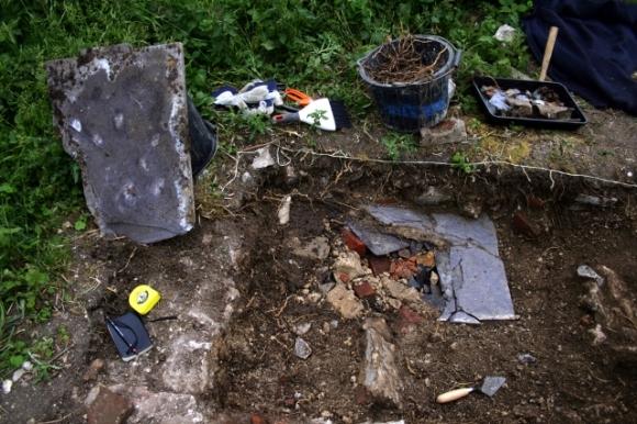 Demolition rubble under slate slab