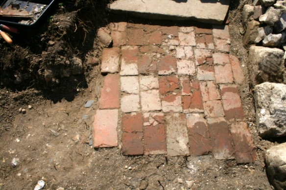 Photo of brick paved path taken from path junction; facing direction of front door (top), with toilet off to the right and front garden gate off to the left