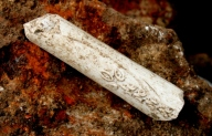 Close up of decorated pipe stem; 16th August 2013.