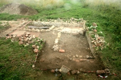 Looking W across excavated area N of house from bulldozed rubble mound; 16th August 2013.