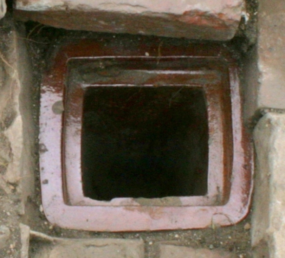 Gulley drain in front of junction of scullery/kitchen and woodshed