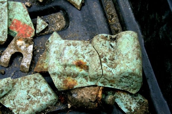 Green painted(?) plaster(?) shards of mystery object