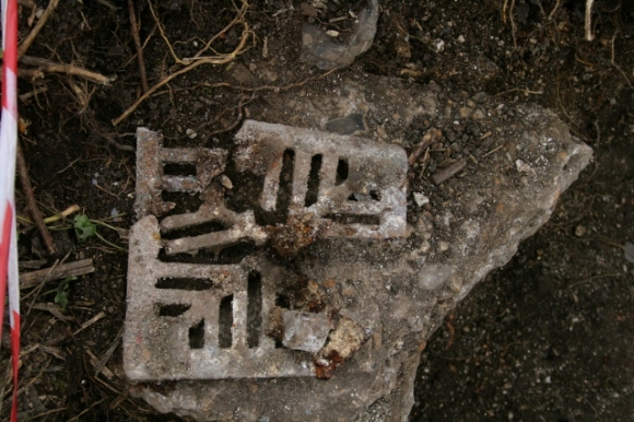 Fragmented cast iron grating, probably for our gully drain