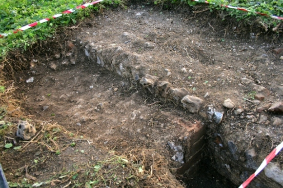 Looking SW at a mortar surface S of the 'woodstore', E of the kitchen