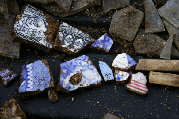 Decorative ceramic shards and clay pipe stems