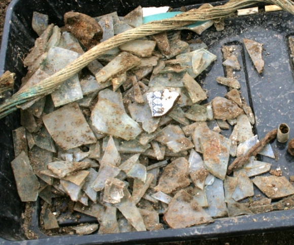 Window glass fragments from area roughly outside NE corner of extension