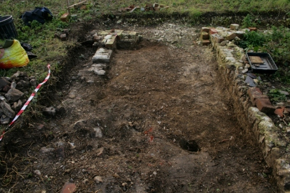 Looking W at foundations of extension at S end of cottage