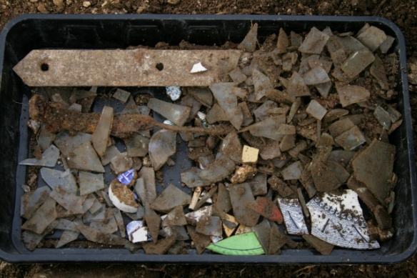 Finds tray from partially excavated grid square S of cottage, E of ~1880 extension
