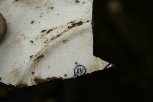 Reverse of decorated dinner plate shard from partially excavated grid square S of cottage, E of ~1880 extension