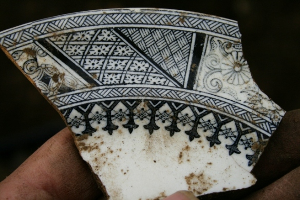 Decorated dinner plate shard from partially excavated grid square S of cottage, E of ~1880 extension