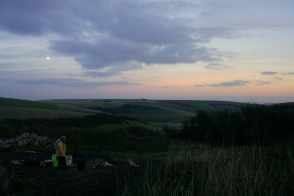 Loking E at sunset and full moon over dig site and Castle Hill NNR