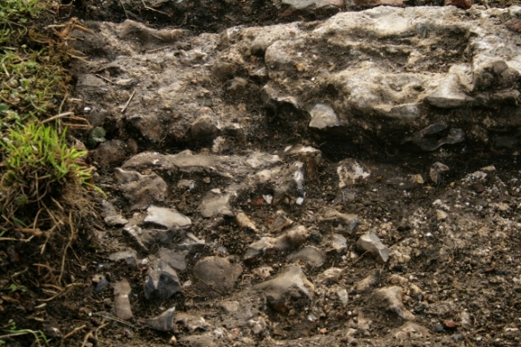 Looking S at cobbled surface N of garden gateway with chalk rubble to right