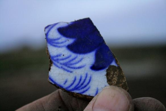 Blue and white ceramic shard