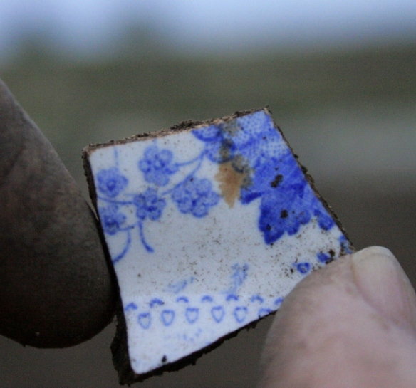 Blue and white ceramic shard