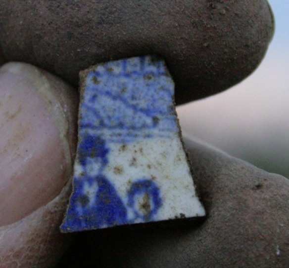 Blue and white ceramic; decorated with image of 2 figures