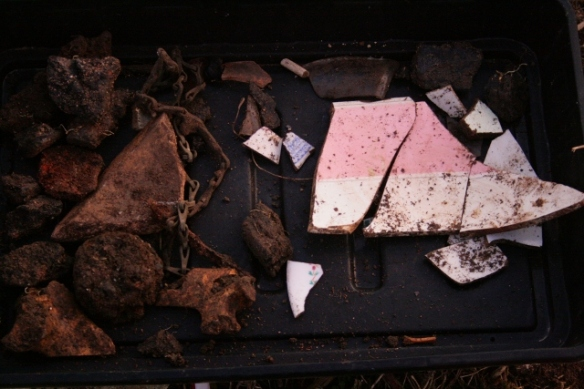 Finds tray from excavation of demolition rubble from E of chimney base