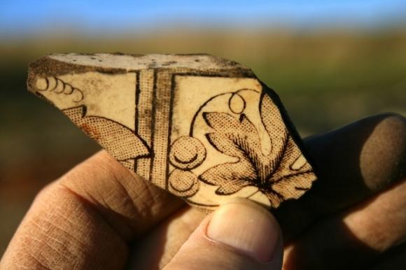 Part of gape vine decorated ceramic wall tile
