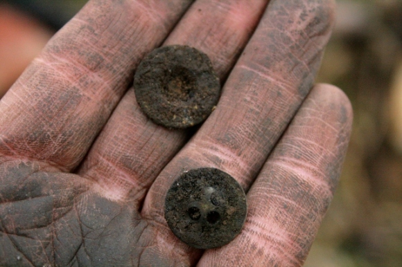 Buttons from mideen deposit E of chimney base