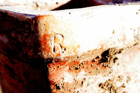 Salt glazed stoneware gully drain with manufacturer's initial; 'R.'