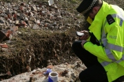 """Police inspecting suspected 3"""" mortar; 9th February 2014"""