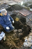 Looking SW at excavation of cobbled flint surface between front garden gate & front door of cottage; 9th February 2014