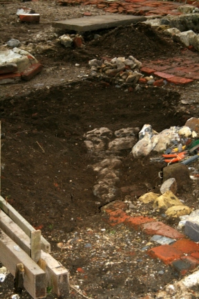 Looking SW at excavation of cobbled flint surface from front front garden gateway to front doorstep of cottage; 9th February 2014