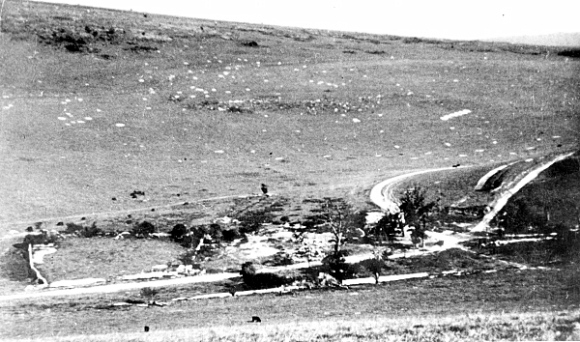 Shattered remains of Balsdean Farm at the end of the war, showing mortar and shell craters on hillside.