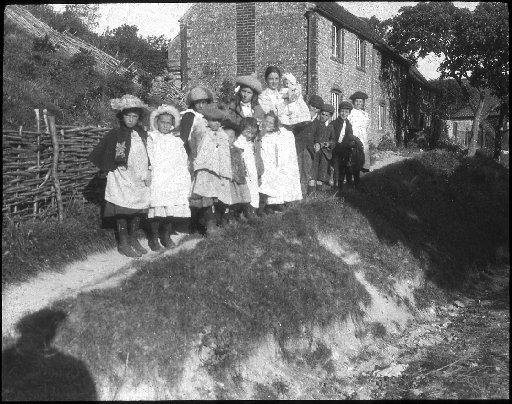 Some women and children of Telscombe village taken in 1904 by Ambrose Gorham. From ESRO, AMS6595.