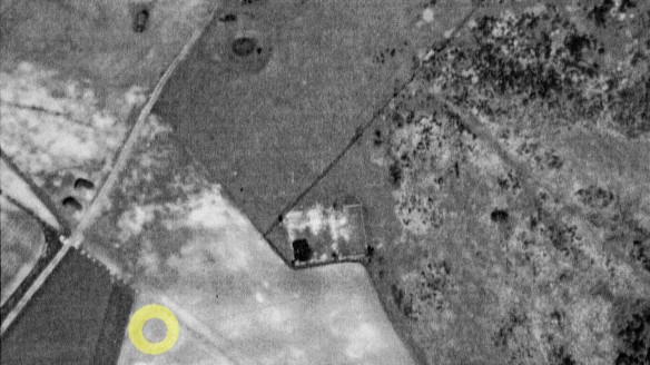 WW2 aerial photograph of Newmarket Farm, including enhanced plough mark of possible Bronze Age barrow.